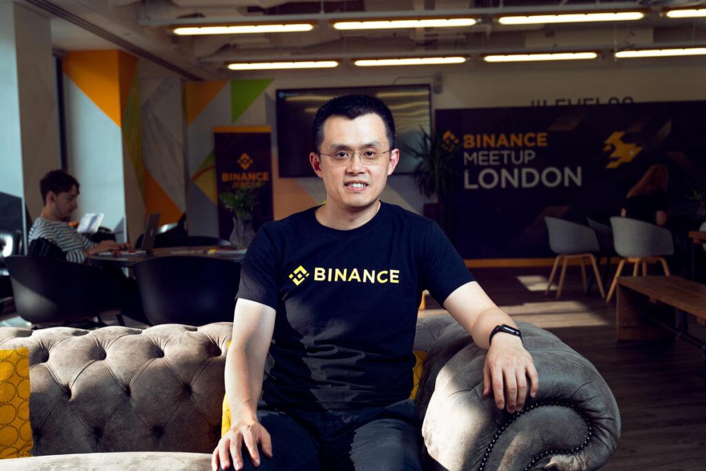 Changpeng Zhao sitting on a sofa