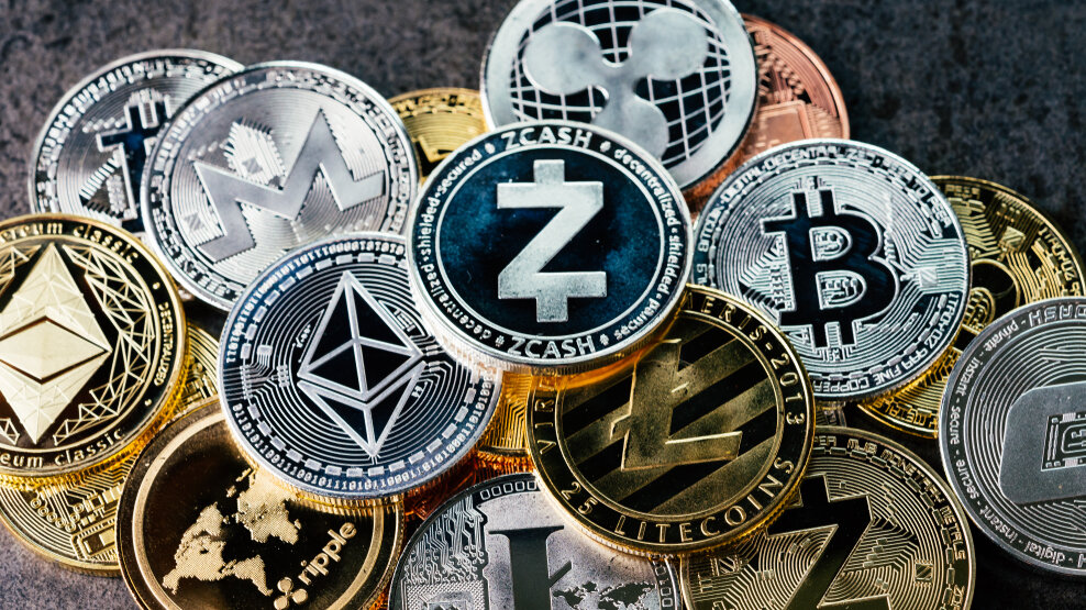 A pile of cryptocurrency coins