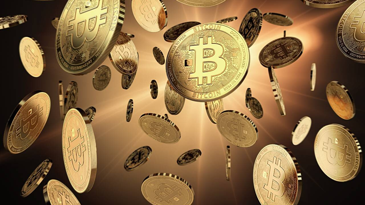 A number of Bitcoin coins falling down