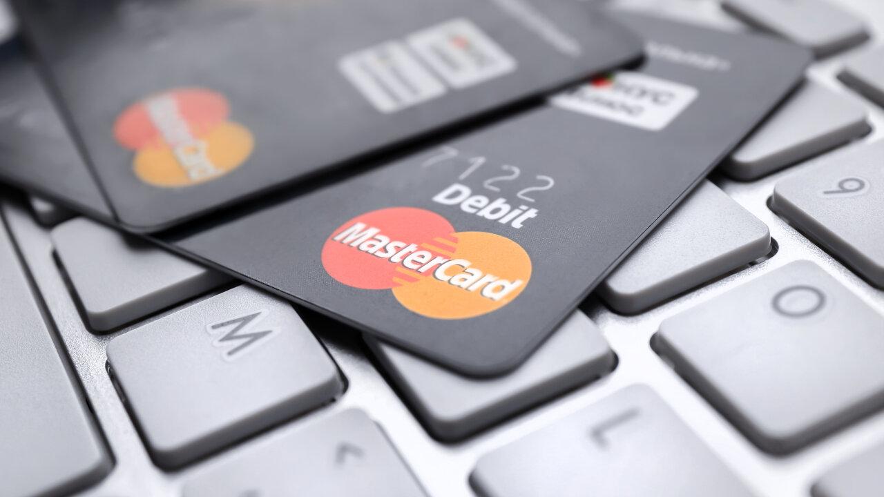 Mastercard debit cards on a keyboard