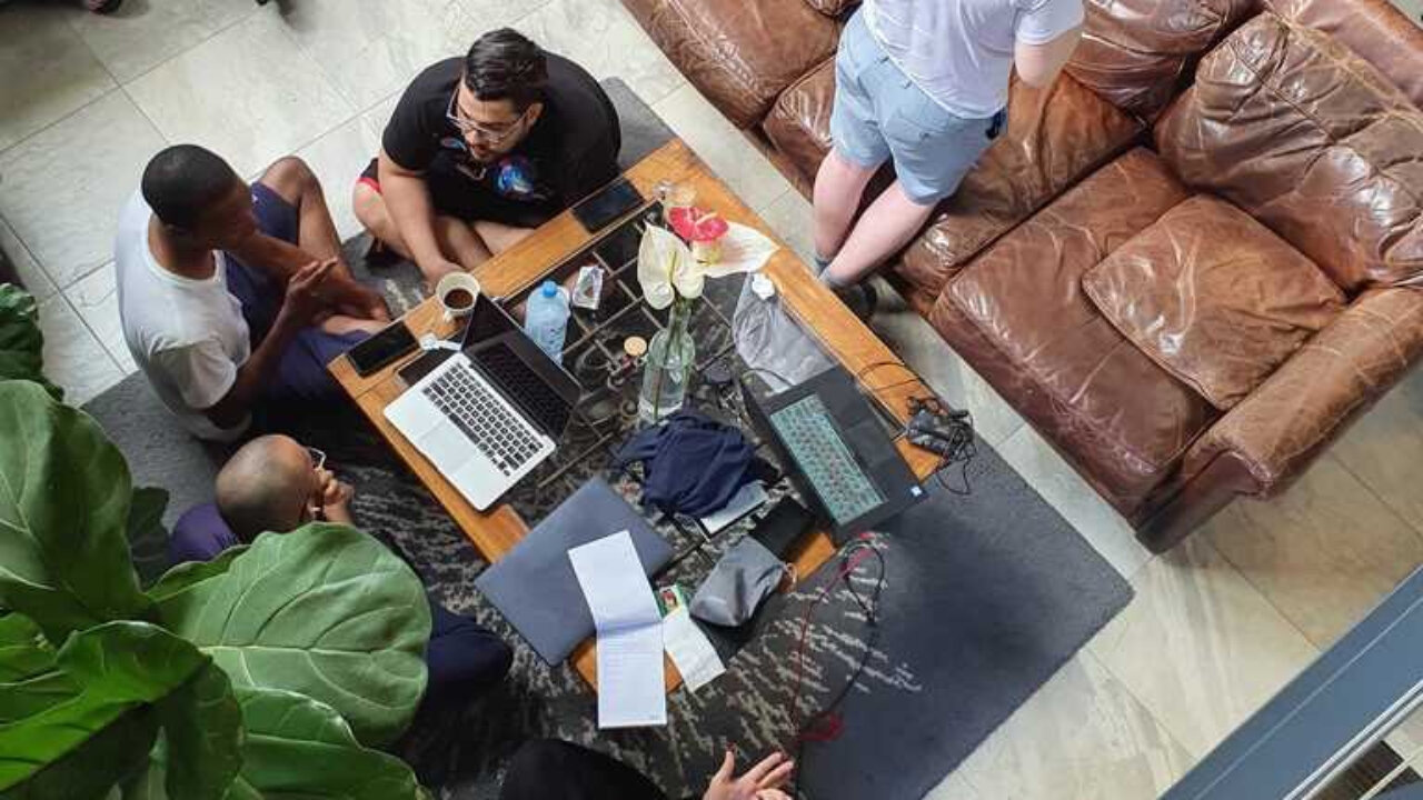 People sitting around a laptop computer