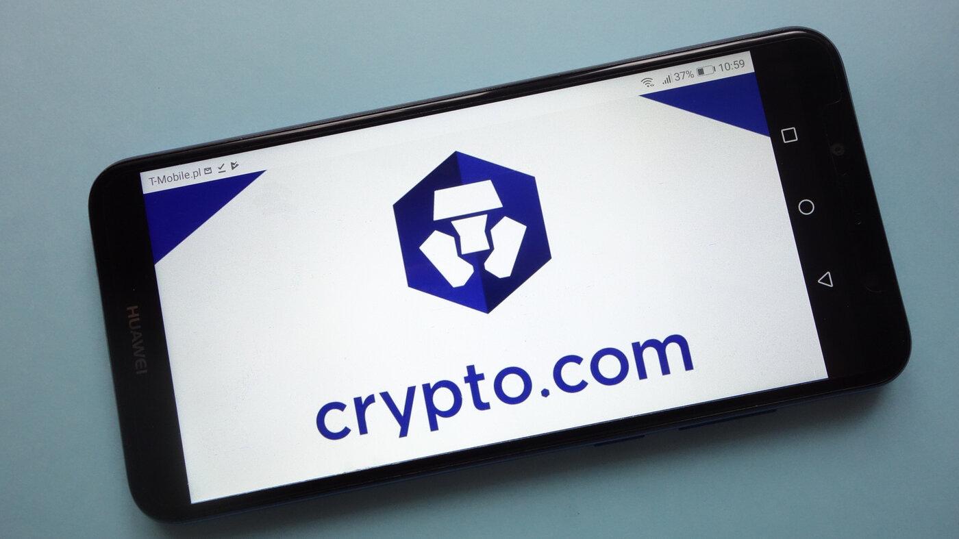 Crypto.com (MCO) cryptocurrency logo displayed on smartphone