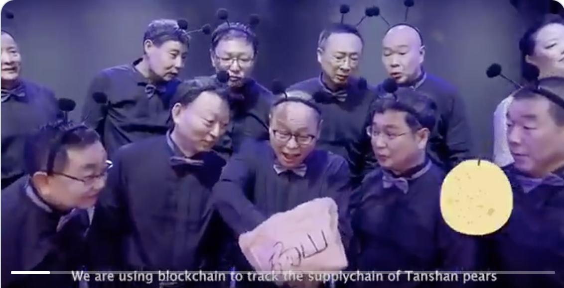 Old men singing in AntChain ad