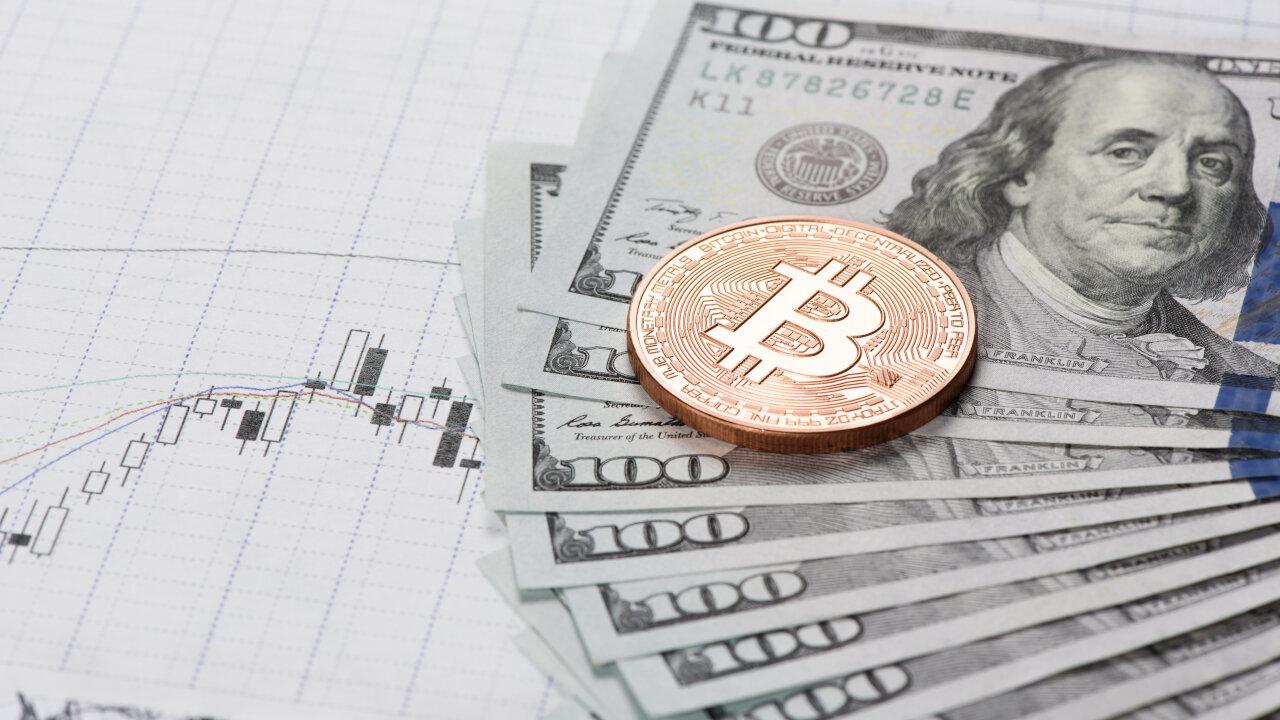 Bitcoin next to US dollars
