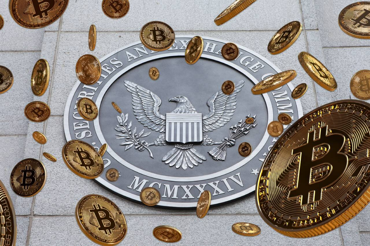 Gold Bitcoins falling in front of SEC seal