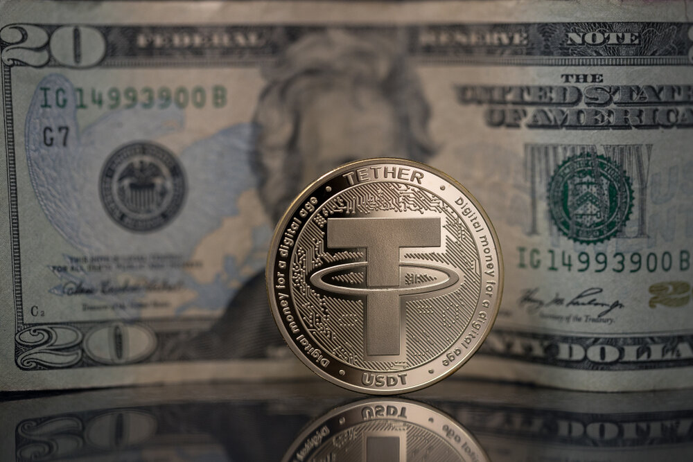 Tether coin in front of $20 bill