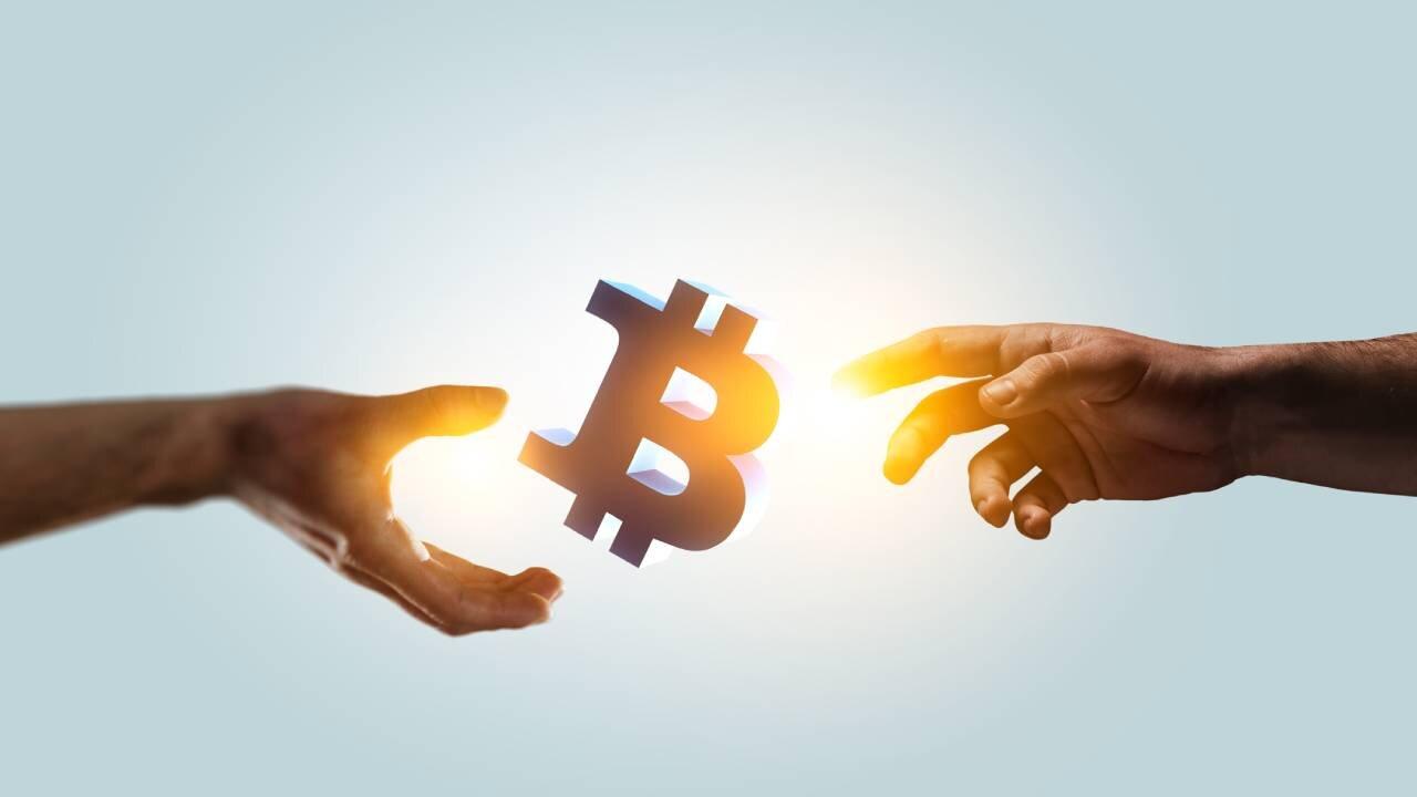 Bitcoin B between two hands