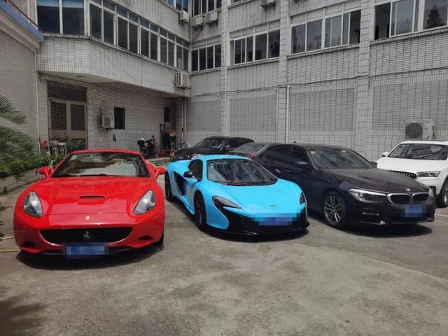 Luxury rides Ferrari and McLaren were among the seized property. Image: Toutiao