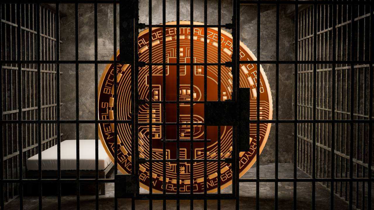 A gold bitcoin locked in a jail cell
