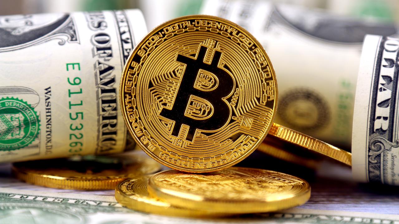 Bitcoin near dollar bills