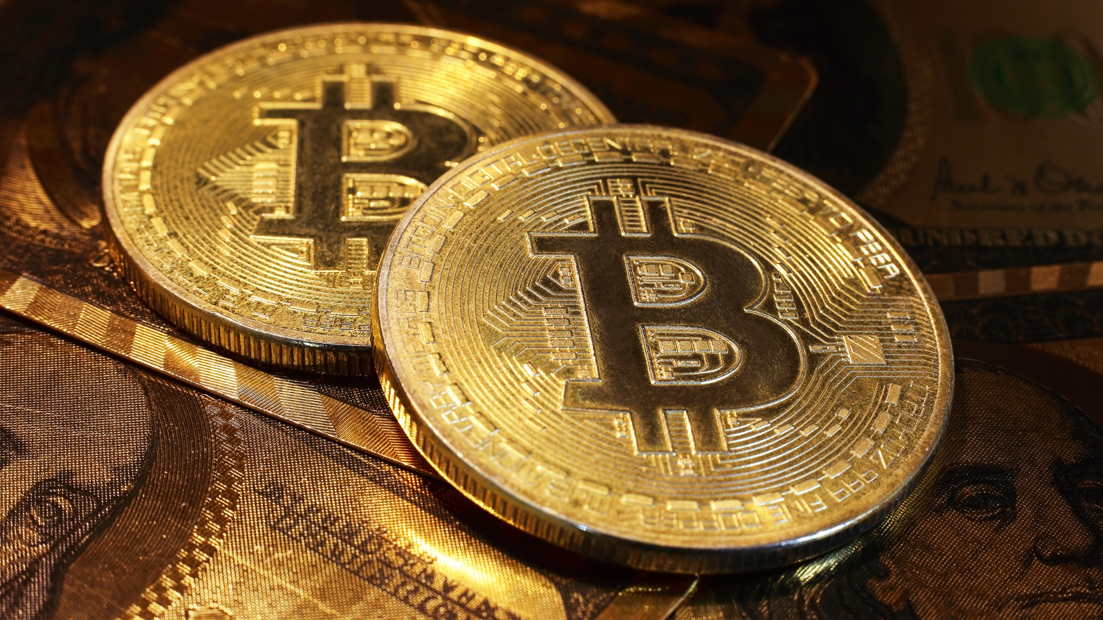 Golden bitcoin with dollar background