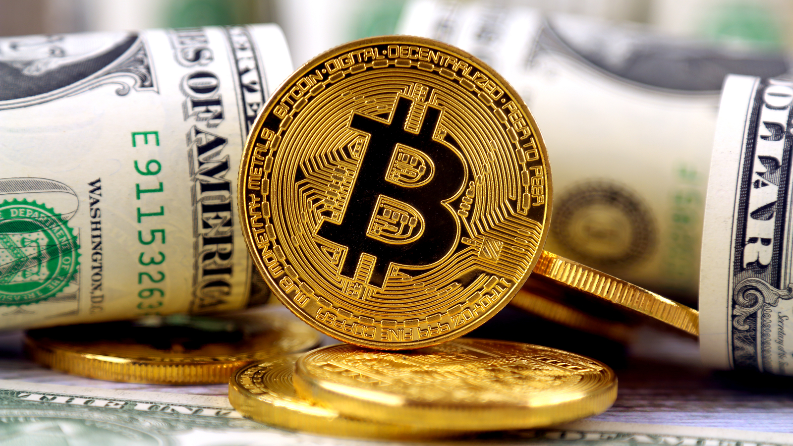 Physical version of Bitcoin (new virtual money) and banknotes of one dollar