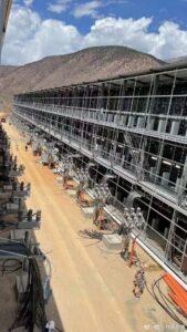 Desert filled with empty Bitcoin mining racks.